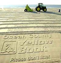 Песочная реклама на пляже