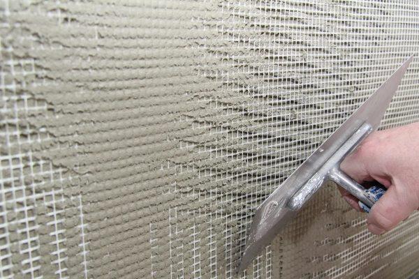 Штукатурка стен по сетке